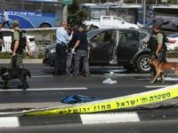 Israeli forensic policemen collect evidence from a car belonging to a victim following a shooting attack near the Israeli police headquarters in mainly Palestinian east Jerusalem on October 9, 2016. A shooting attack in Jerusalem left at least three people wounded, including two seriously, with the assailant killed by police, …