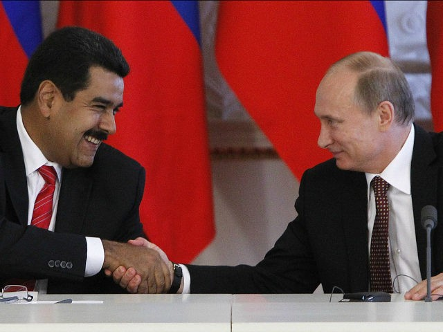 Russia's President Vladimir Putin (R) and his Venezuelan counterpart Nicolas Maduro shakes hands during a signing ceremony at the Kremlin in Moscow, on July 2, 2013. Fugitive US intelligence leaker Edward Snowden was denied asylum by a host of countries today after applying for a safe haven in 21 nations spanning the globe in hopes of winning protection from American justice. Snowden found particular support in Maduro .But Maduro refused to entertain speculation he might take Snowden on a plane with him from Moscow -- a possibility raised both by Russian media and political observers of the explosive case. AFP PHOTO / POOL/ MAXIM SHEMETOV (Photo credit should read MAXIM SHEMETOV/AFP/Getty Images)