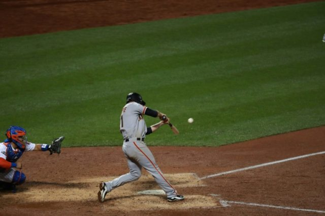 Conor Gillaspie of the San Francisco Giants hits a three-run home run in the ninth inning against the New York Mets on October 5, 2016