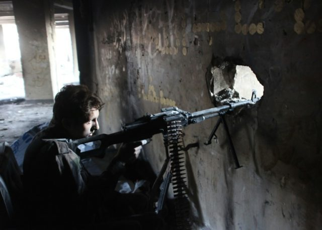 A member of Syria's pro-government forces guards a look out point as they advance Aleppo's rebel-held Bustan al-Basha neighbourhood on October 6, 2016
