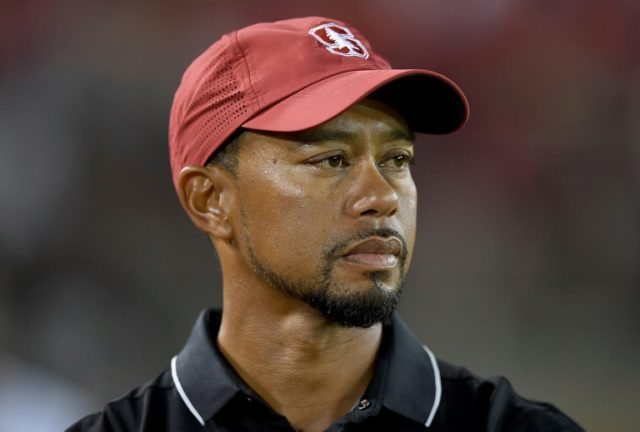 Tiger Woods looks on from the sidelines during an NCAA football game between the Washington State Cougars and Stanford Cardinal, at Stanford Stadium in Palo Alto, California, on October 8, 2016