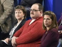 Ken Bone (C) listens to US Democratic nominee Hillary Clinton and Republican nominee Donald Trump during the second presidential debate at Washington University in St. Louis, Missouri