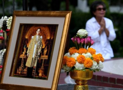 A woman mourns the death of Thailand's King Bhumibol Adulyadej at Bangkok's Siriraj Hospital