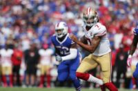 Colin Kaepernick of the San Francisco 49ers runs the ball against the Buffalo Bills on October 16, 2016