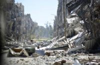 According to an official at the Syrian branch of the Palestine Liberation Organisation, IS has destroyed gravestones in the embattled Palestinian refugee camp of Yarmuk on the outskirts of Damascus, Syria