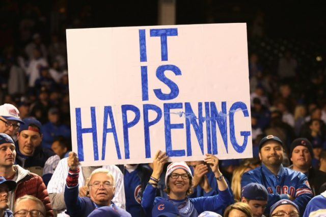 Chicago Cubs fans hold a sign after the Cubs defeated the Los Angeles Dodgers 5-0 to advance to the World Series for the first time in 71 years