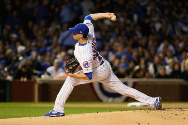 Kyle Hendricks of the Chicago Cubs throws a pitch in the first inning against the Los Angeles Dodgers during game six of the National League Championship Series, at Wrigley Field in Chicago, Illinois, on October 22, 2016