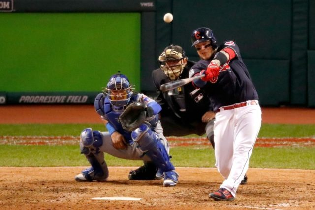 Roberto Perez of the Cleveland Indians hits a three-run home run during the eighth inning against the Chicago Cubs in Game One of the 2016 World Series