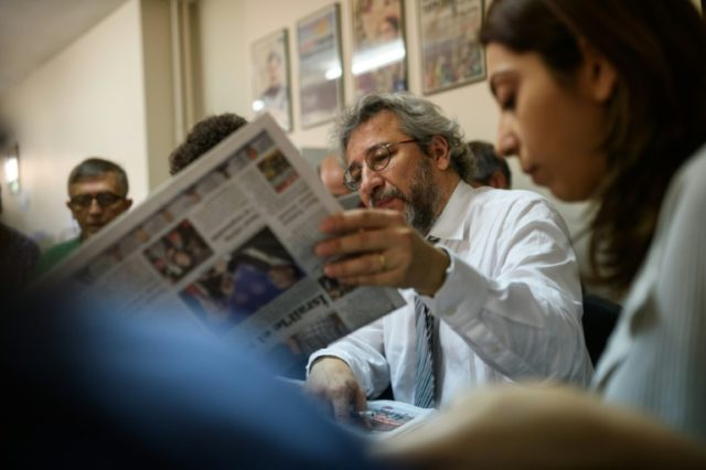 Exiled Turkish journalist Can Dundar (C), is among those shortlisted for the European Parliament's prestigious Sakharov human rights prize