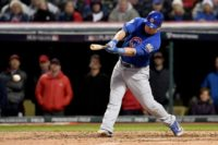 Kyle Schwarber of the Chicago Cubs hits an RBI single to score Ben Zobrist (not pictured) against the Cleveland Indians in Game Two of the 2016 World Series