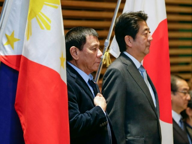 Japan is one of the top US allies in Asia, and Rodrigo Duterte (L) said Shinzo Abe (R) had raised the issue with him in a meeting