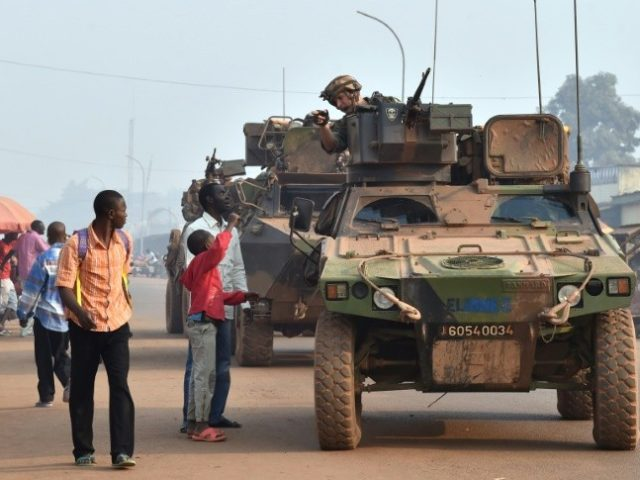 French Sangaris forces patrol in Bangui, central African Republic in February 2016 as people vote in presidential elections hoping to bring peace after the country's worst sectarian violence since independence in 1960