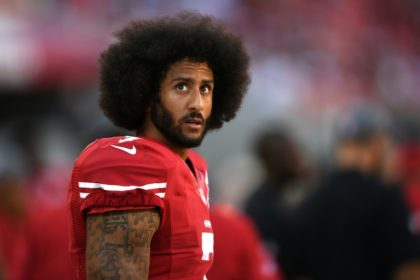 Colin Kaepernick of the San Francisco 49ers looks on from the sidelines during the game against the Tampa Bay Buccaneers on October 23, 2016 in Santa Clara, California