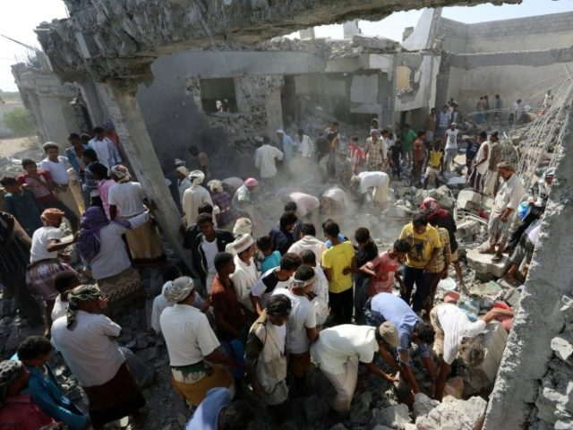 Yemenis gather amidst the rubble at a detention centre hit by Saudi-led coalition air strikes in al-Zaidia district of the Red Sea port city of Hodeidah, on October 30, 2016