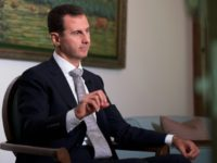 Embattled Syrian President Bashar al-Assad, seen in July 2016, called new Lebanese President Michel Aoun to congratulate the regional neighbor on on his election
