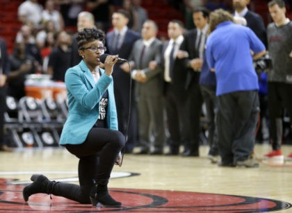 Team Employee Kneels While Singing Anthem Before Heat-76ers Game