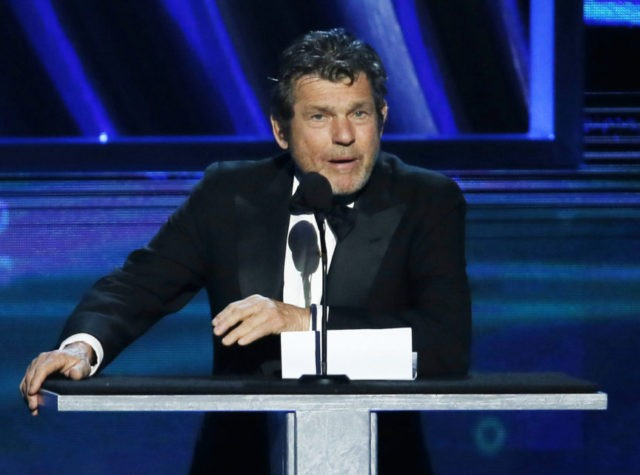 "FILE - In this April 18, 2013 file photo, ""Rolling Stone"" magazine editor and publisher, Jann Wenner, speaks during the Rock and Roll Hall of Fame Induction Ceremony in Los Angeles. On Friday, Oct. 28, 2016, jurors viewed Wenner's video deposition where he says that he disagreed with a top …"