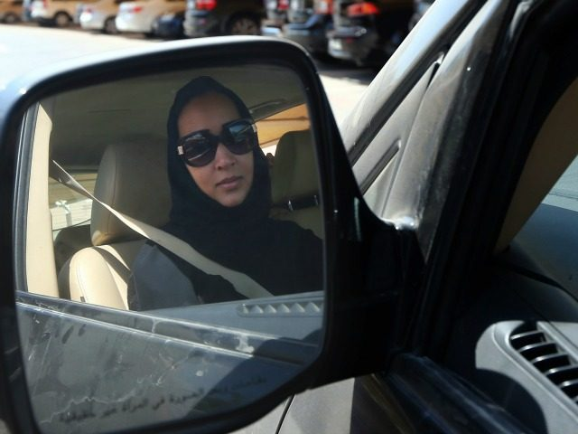 Saudi activist Manal Al Sharif, who now lives in Dubai, drives her car in the Gulf Emirate city on October 22, 2013, as she campagins in solidarity with Saudi women preparing to take to the wheel on October 26, defying the Saudi authorities, to fight for women's right to drive …