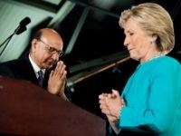 Khizr Khan, the father of fallen Army Capt. Humayun Khan, left, introduces Democratic presidential candidate Hillary Clinton, right, during a rally at The Armory at the Radisson Hotel in Manchester, N.H., Sunday, Nov. 6, 2016. (