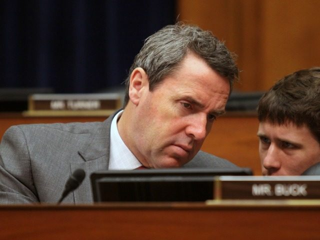 Rep. Mark Walker (R-NC) speaks to a staff member. Members of the House Committee on Oversight and Government Reform met to consider a censure or IRS Commissioner John Koskinen on Wednesday, June 15, 2016 on Capitol Hill in Washington.