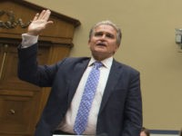 Witnesses are sworn in to testify before the House Oversight and Government Reform Committee hearing on classifications and redactions in FBI's investigative file of former Secretary of State Hillary Clinton, in Washington, Monday, Sept. 12, 2016. From left Peter Kadzik, Assistant Attorney General for Legislative Affairs, U.S. Department of Justice; …