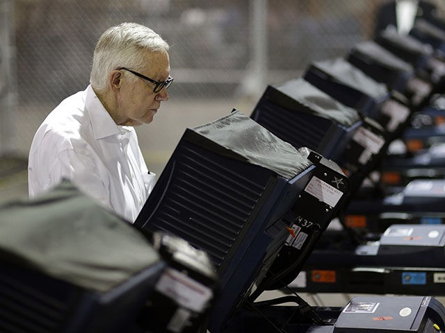 Senate Minority Leader Harry Reid of Nev., votes at an early voting site Wednesday, Oct. 26, 2016, in Las Vegas. When Sen. Harry Reid cast the last vote he'll make as a U.S. Senator, he did it in a Las Vegas Strip early voting site surrounded by casino workers in …