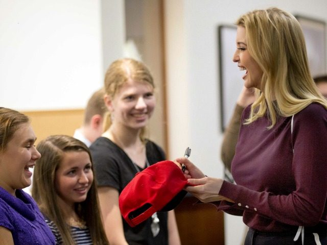Ivanka Trump signs a hat during a campaign stop for her father, Republican presidential candidate Donald Trump, Thursday, Nov. 3, 2016, at the Founders Academy, a public chartered school in Manchester, N.H.