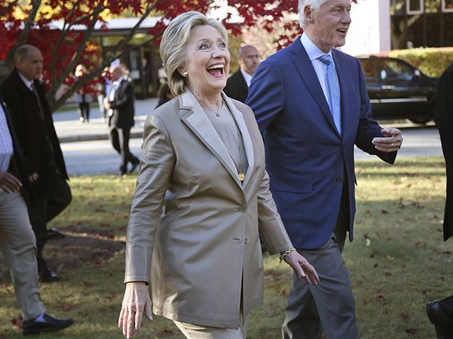 Democratic presidential candidate Hillary Clinton and her husband, former President Bill Clinton, greet supporters after voting in Chappaqua, N.Y., Tuesday, Nov. 8, 2016. (AP Photo/Seth Wenig)