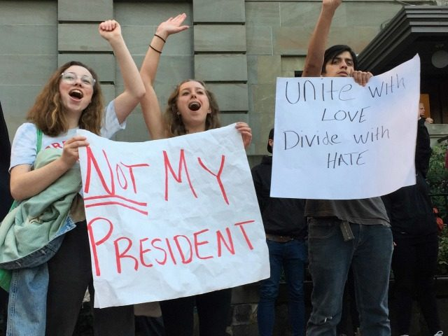 Several dozen students from various high schools in the Portland, Ore., metropolitan area gather downtown to protest Republican nominee Donald Trump's victory in Tuesday's presidential election, Wednesday, Nov. 9, 2016. The protests were peaceful and students said that they felt compelled to demonstrate against Trump because they were not old enough to vote. (