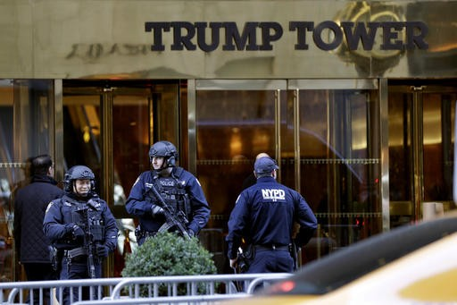 New York City Police guard the front of Trump Tower, in New York, Friday, Nov. 11, 2016. Around the country from New York to Chicago to California, hundreds of demonstrators marched through streets protesting Donald Trump's election. (AP Photo/Richard Drew)