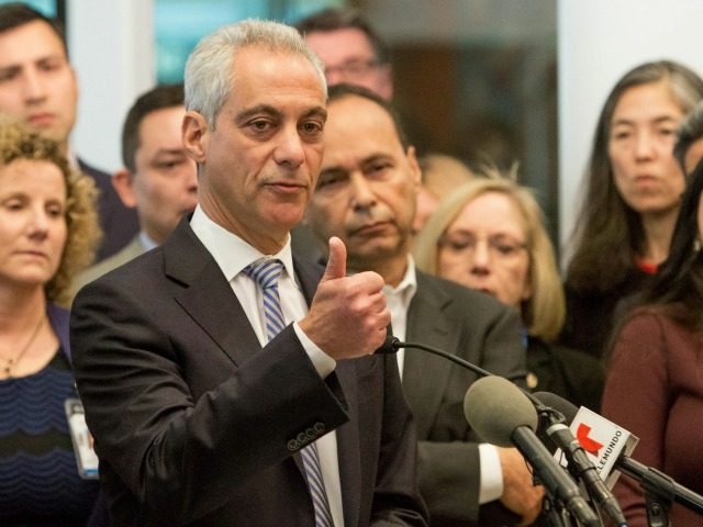 Chicago Mayor Rahm Emanuel, center, speaks at a news conference Monday, Nov. 14, 2016, in Chicago. Emanuel said the outcome of the U.S. presidential election will not impact Chicago's commitment as a sanctuary city for immigrants.