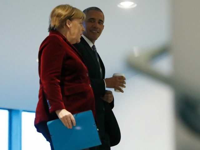 President Barack Obama walks with German Chancellor Angela Merkel at the German Chancellery in Berlin, Thursday, Nov. 17, 2016. (