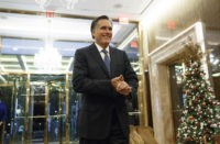 Former Republican presidential nominee Gov. Mitt Romney talks with reporters after eating dinner with President-elect Donald Trump at Jean-Georges restaurant, Tuesday, Nov. 29, 2016, in New York. (AP Photo/Evan Vucci)