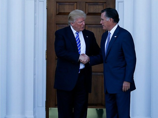 Mitt Romney (L) leaves after meeting with United States President-elect Donald Trump (R) and Vice President-elect Mike Pence (unseen) at the clubhouse of Trump International Golf Club, November 19, 2016 in Bedminster Township, New Jersey.