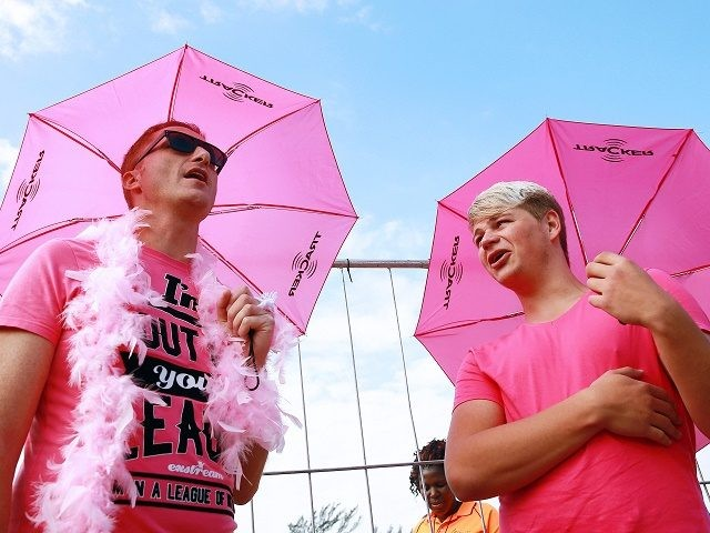 A gay couple attends the annual Lesbian, Gay, Bisexual and Transgender (LGBT) Pride Parade as part of the Durban Pride Day Festival in Durban, South Africa, on June 28, 2014. AFP PHOTO / RAJESH JANTILAL (Photo credit should read RAJESH JANTILAL/AFP/Getty Images)