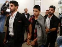 Ahmed Manasra (C), a 14-year old Palestinian boy, convicted of the attempted murder of two Israelis in a stabbing in October 2015, leaves the District Court in Jerusalem after his sentencing hearing on November 7, 2016. The court sentenced Manasra to 12 years in jail for the knife attack, his …