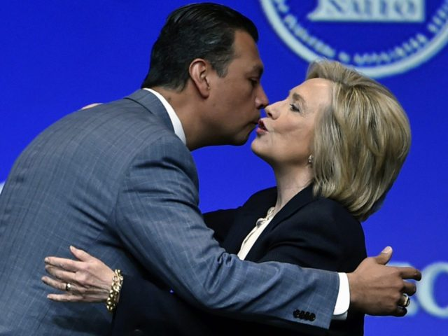 Alex Padilla kisses Hillary Clinton (David Becker / Associated Press)