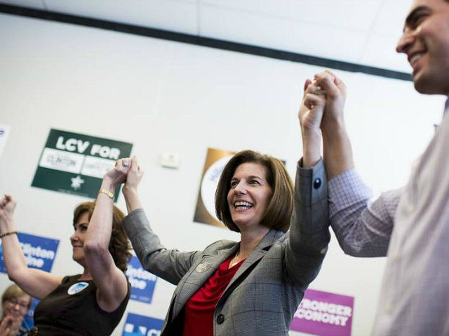 UNITED STATES - NOVEMBER 5: From left, Jacky Rosen, Democratic candidate for Nevadas 3rd Congressional district, Catherine Cortez Masto, Democratic candidate for U.S. Senate from Nevada, and Ruben Kihuen, Democratic candidate for Nevadas 4th Congressional district, hold hands in the air after speaking to campaign volunteers at a campaign office …