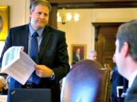 Democratic candidate for governor, Executive Councilor Colin VanOstern, right listens to his Republican rival for governor, Executive Councilor Chris Sununu during the last Executive Council meeting before the election Wednesday, Oct. 26, 2016, in Concord, N.H. (AP Photo/Jim Cole)