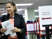 A voter exits the Hamilton County Board of Elections after casting her ballot as early voting begins statewide, Wednesday, Oct. 12, 2016, in Cincinnati. (AP Photo/John Minchillo)