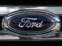 COLMA, CA - JULY 28: The Ford logo is displayed on the front of a brand new Ford truck at Serramonte Ford on July 28, 2015 in Colma, California. Ford Motor Co. reported second quarter earnings that beat analysts' expectations with earnings of $37.3 billion or 47 cents a share …