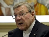 "Australian Cardinal George Pell, Prefect of the Secretariat for the Economy of the Holy See, attends a press conference on March 31, 2014 in Vatican. Cardinal George Pell and Italian writer Francesco Lozupone presented the book ""Co-responsability and transparency in the administration of church property"". AFP PHOTO / ANDREAS SOLARO …"