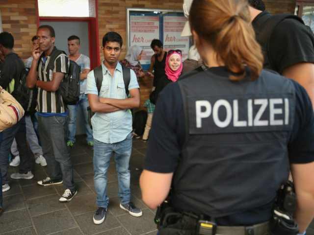 German police and migrants