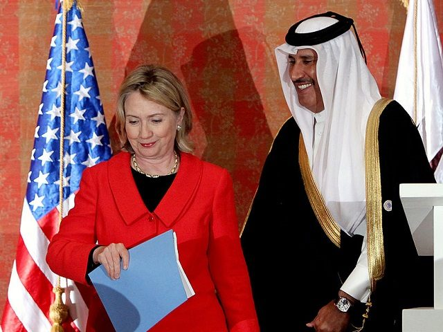 US Secretary of State Hillary Clinton leaves with her Qatari counter part and Prime Minister Sheikh Hamad Bin Jassem Bin Jaber following their joint press conference in Doha, January 12, 2011. AFP PHOTO/MARWAN NAAMANI (Photo credit should read MARWAN NAAMANI/AFP/Getty Images)