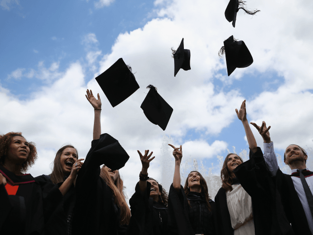 LONDON, ENGLAND - JULY 15: Students throw their caps in the air ahead of their graduation ceremony at the Royal Festival Hall on July 15, 2014 in London, England. Students of the London College of Fashion, Management and Science and Media and Communication attended their graduation ceremony at the Royal …