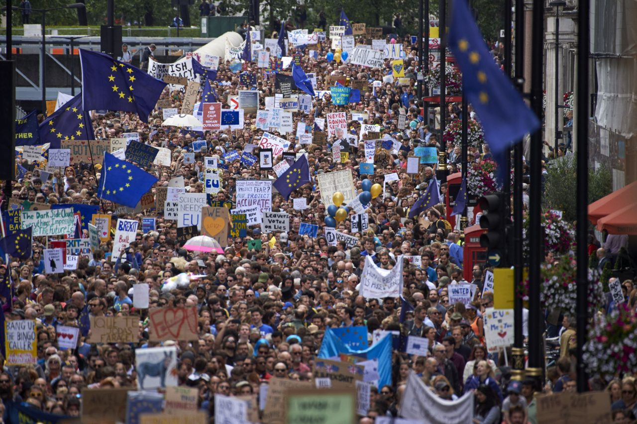 People hold up pro-Europe placards and European flags as thousands of protesters take part in a March for Europe, through the centre of London on July 2, 2016, to protest against Britain's vote to leave the EU, which has plunged the government into political turmoil and left the country deeply polarised. Protesters from a variety of movements march from Park Lane to Parliament Square to show solidarity with those looking to create a more positive, inclusive kinder Britain in Europe. / AFP / Niklas HALLE'N (Photo credit should read NIKLAS HALLE'N/AFP/Getty Images)