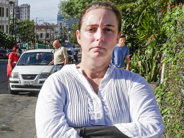 (ALTERNATIVE CROP) Cuban performance artist Tania Bruguera poses for a picture in a street of Havana, on December 31, 2014, upon her released from a police station. Bruguera was briefly released Wednesday but was re-arrested when she tried to go to Havana's main seaside avenue, the Malecon, to hold a press conference with other activists. Authorities had arrested Bruguera and 50 other dissidents yesterday to stop them from attending an open mic session convened by her at Revolution Square, an iconic plaza in front of Cuba's government headquarters, for Cubans to speak out about their future. The Cuban crackdown on dissident activists caused a new rift Wednesday with the United States, the first diplomatic scuffle since this month's historic announcement of a renewal in ties. AFP PHOTO / Adalberto ROQUE (Photo credit should read ADALBERTO ROQUE/AFP/Getty Images)