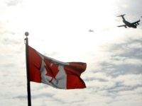 f Canada's troops in Afghanistan is escorted through the air by fighter jets, after the last Canadian troops from Afghanistan returned to Ottawa International Airport on March 18, 2014 in Ottawa, Ontario. Eighty-four armed forces members were welcomed home marking the end of Canada's participation in the Afghanistan war, a …