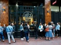 Guests wait to enter an in store private event launching Levi's new Woman's Denim Collection on July 15, 2015 in San Francisco, California. (Photo by )