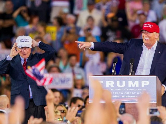 . Republican presidential candidate Donald Trump introduces Alabama Senator Jeff Sessions (R) Mobile during his rally at Ladd-Peebles Stadium on August 21, 2015 in Mobile, Alabama. The Donald Trump campaign moved tonight's rally to a larger stadium to accommodate demand. (Photo by